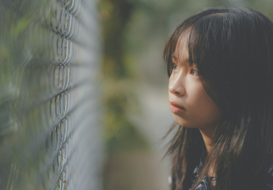 Credit: https://www.pexels.com/photo/thoughtful-asian-girl-looking-through-grid-6587286/  Day 3 | Image of the day